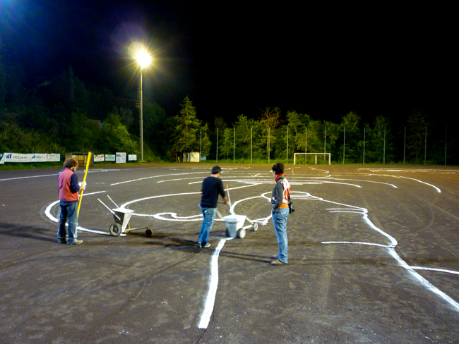Chalk drawing on the pitch